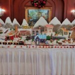 Christmas-train-gingerbread-village-snow-covered-valley-and-mountains