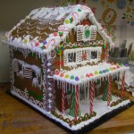 Gingerbread-house-with-candy-cane-pourch-and-sweet-candy-roof